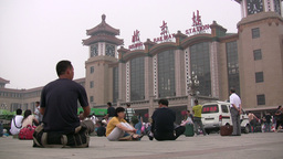 People wait in front of the Beijing Railway Statio Stock Video Footage