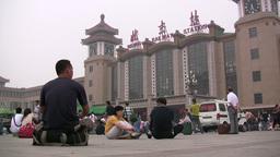 People wait in front of the Beijing Railway Statio Footage