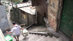 Chinese man carries heavy boxes with eggs down the Stock Video Footage