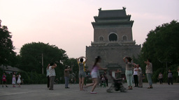 eople are working out near a traditional temple in Stock Video Footage
