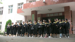 Chinese students graduate and throw hats in the ai Stock Video Footage