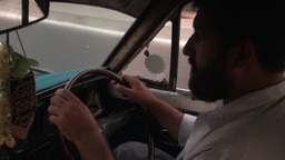 Inside a cab - Karachi taxi driver Stock Video Footage