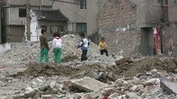 Kids are playing in a demolished quarter in China Stock Video Footage