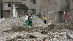 Kids Are Playing In A Demolished Quarter In China stock footage