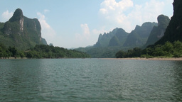 Sailing over the beautiful Li river surrounded by Stock Video Footage