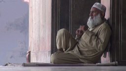 Man puts on other glasses in a mosque in Pakistan Stock Video Footage
