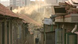 New buildings arise behind old Communist houses in Stock Video Footage