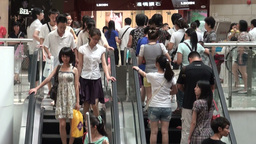 People on escalators in Guangzhou shopping mall, C Stock Video Footage