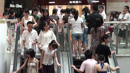 People on escalators in Guangzhou shopping mall, C Footage