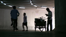 A vendor sells food in an underpass in Beijing, Ch Footage