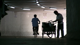 A vendor sells food in an underpass in Beijing, Ch Stock Video Footage