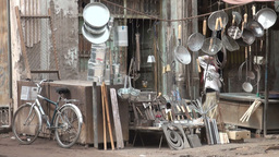 Street scene in Kashgar - girl is setting up shop Stock Video Footage