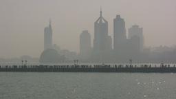 Skyline of Chinese city, tourists, and jetski Stock Video Footage