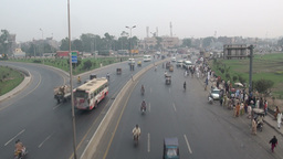 Traffic drives on a highway in Pakistan Stock Video Footage