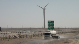 Highway and local road near Chinese wind farm Stock Video Footage