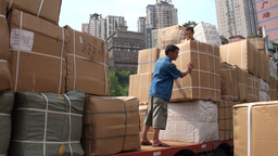 Worker loading huge box on truck in Chongqing Stock Video Footage