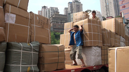 Worker loading huge box on truck in Chongqing Footage