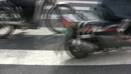 Detailed view of bicycles and motorbikes on zebra Stock Video Footage