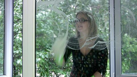 Girl washing window Footage