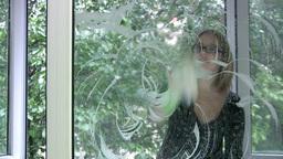 Girl washing window Stock Video Footage