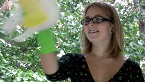 Girl washing window closeup Footage