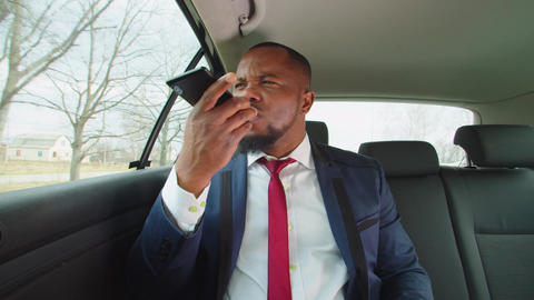 Strict black entrepreneur making voice call conference in vehicle Live Action