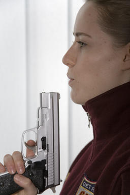 woman with pistol Photo