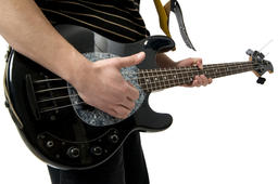 Man playing electric guitar on white background ภาพถ่าย