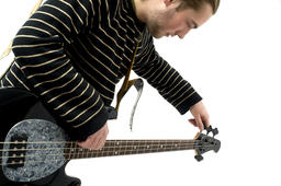 Man playing electric guitar on white background 相片