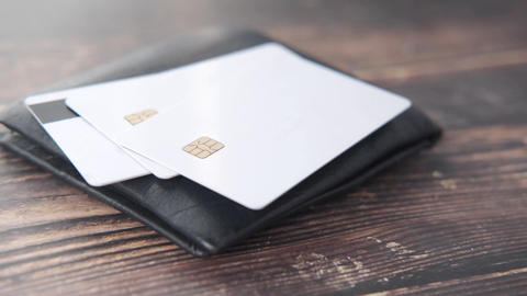 close up of credit cards in a wallet on wooden background Live Action