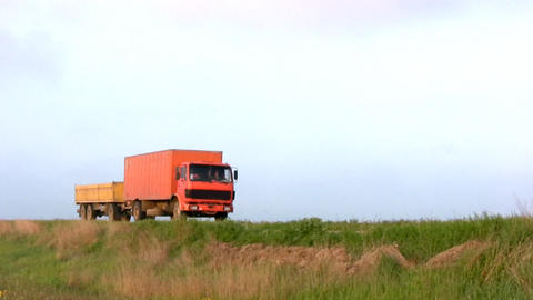 Orange truck leaves Footage
