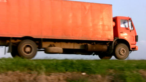 Orange truck leaves Stock Video Footage