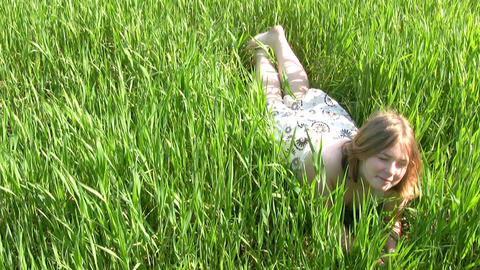 Happy girl in the grass Stock Video Footage
