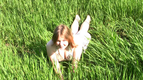Happy girl in the grass Footage