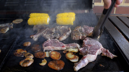 Mutton Chops, Potato and Corn Cooking on a Barbecue Footage