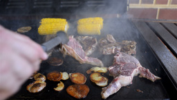 Mutton Chops, Potato and Corn Cooking on a Barbecue Stock Video Footage