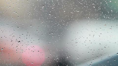 Rain Drops Against Traffic Stock Video Footage