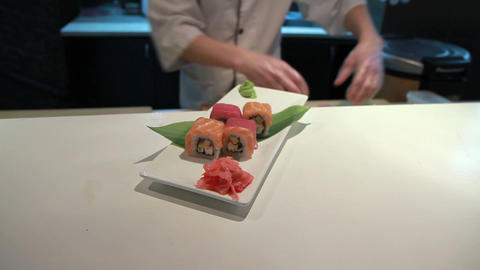 Presentation Of Salmon Sushi Roll Stock Video Footage