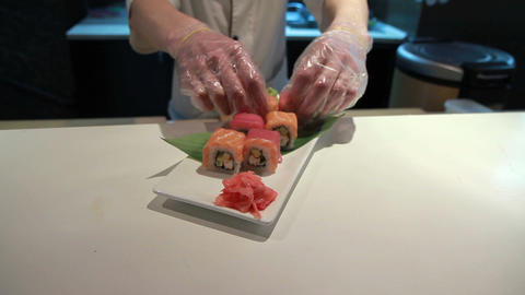 Presentation Of Salmon Sushi Roll Footage
