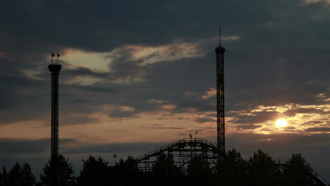 Sunset at a Amusement Park wide shot Stock Video Footage