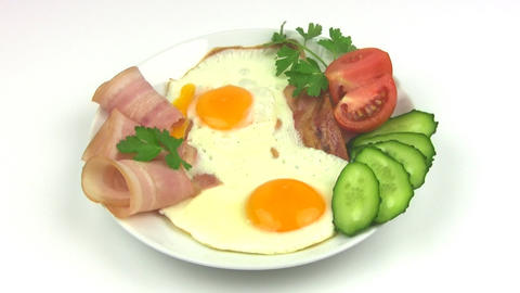 Plate with fried eggs. Seamless Stock Video Footage