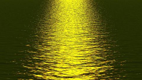 golden light reflecting on ocean Stock Video Footage