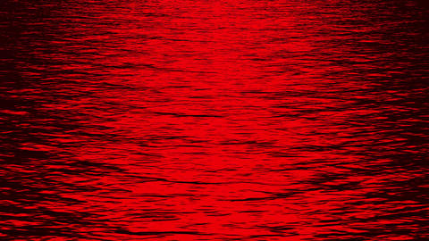 red light reflecting on ocean at night Stock Video Footage