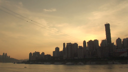 Sun goes down over fast growing Chinese city Stock Video Footage
