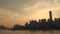 Sun goes down over fast growing Chinese city Footage