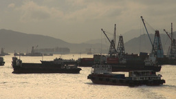 Container ship leaves Hong Kong harbour Stock Video Footage