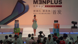 Girl Presenting Auction In Guangzhou Shopping Mall stock footage