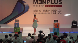 Girl presenting auction in Guangzhou shopping mall Stock Video Footage