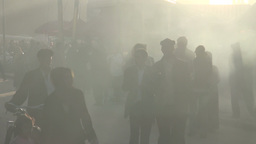Kashgar street people walking through smoke Stock Video Footage