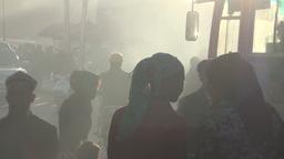 Kashgar street people walking through smoke Stock Video Footage